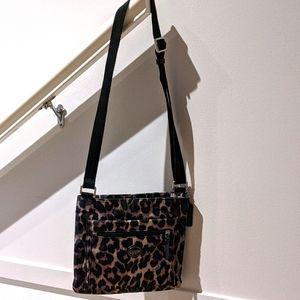 EUC: Coach ocelot leopard print cross body purse